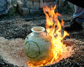 A piece that looks like this during Tom Neugebauer's raku firing...