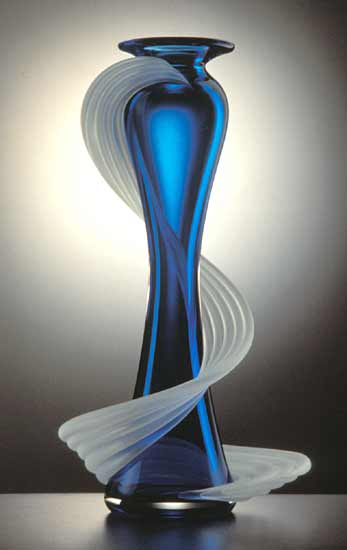 """In this elegant vase, Thomas Kelly captures the essence of the Flamenco dance with its dramatic energy and flamboyant movements. The vase's flawless execution in hot blue transparent glass is contrasted with swirls of frosted elements adding to the visual excitement."" - Michael Monroe (shown: Large Flamenco Vase by Thomas Kelly)"