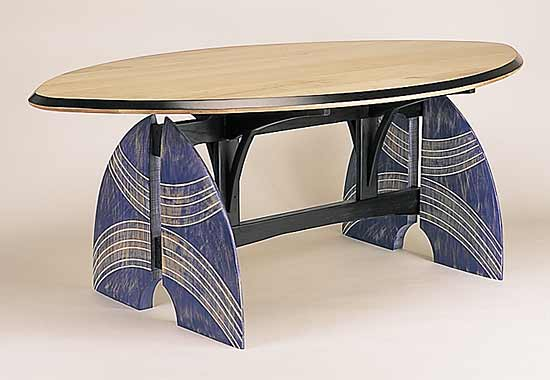 """Feeling a kinship with the innocence, honesty, and directness of primitive art, Erik Wolken constructed this table base, whose carved and painted legs were inspired by African tribal warrior shields."" -- Michael Monroe (shown: Table for my Tribe by Erik Wolken)"